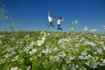 on pasture: happy young couple in love have romance and fun at wheat field in summer