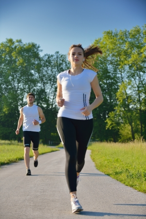 Young couple jogging in park at morning. Health and fitness concept Stock Photo - 15334875