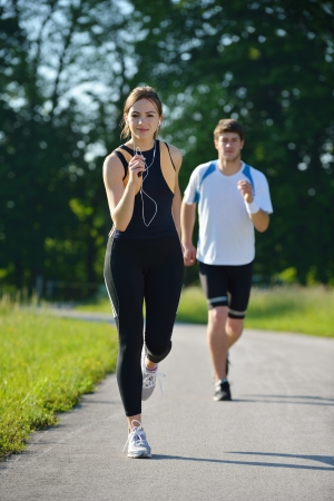 Young couple jogging in park at morning  Health and fitness concept photo