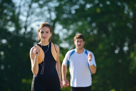 Young couple jogging in park at morning  Health and fitness concept Stock Photo - 17632998