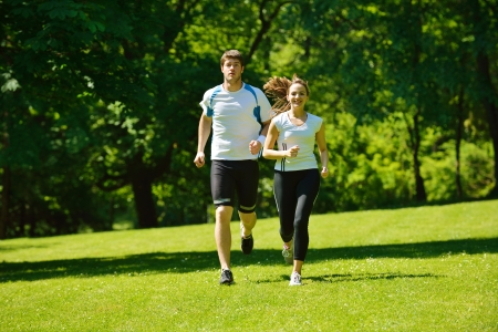 Young couple jogging in park at morning. Health and fitness concept Stock Photo - 15334985