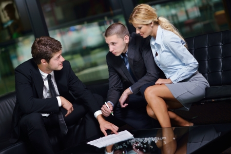 Group of happy young  business people in a meeting at office Stock Photo - 15403110