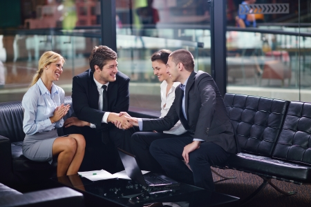 Group of happy young  business people in a meeting at office Stock Photo - 15528223