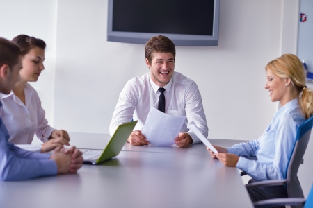 Group of happy young  business people in a meeting at office Stock Photo - 15528450
