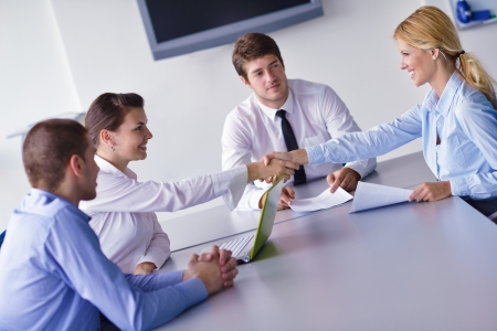 Group of happy young  business people in a meeting at office Stock Photo - 15395473