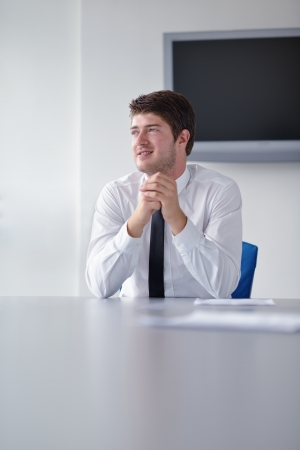 man sit: happy young business  man work in modern office on computer Stock Photo