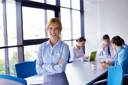 business woman  with her staff,  people group in background at modern bright office indoors Stock Photo - 15527266