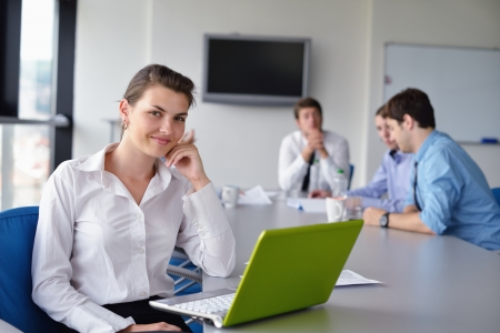 business woman  with her staff,  people group in background at modern bright office indoors Stock Photo - 15528335