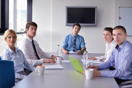 Group of happy young  business people in a meeting at office Stock Photo - 15528294