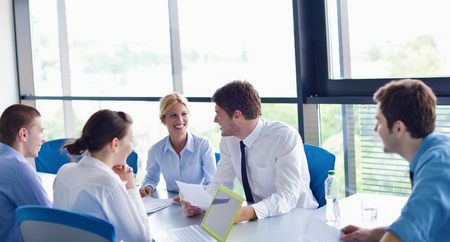 Group of happy young  business people in a meeting at office Stock Photo - 15527212