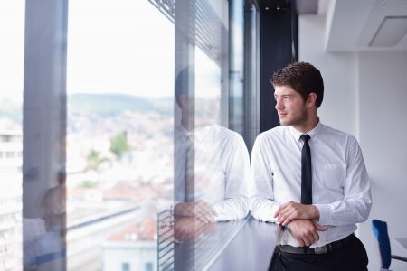 one young man: happy young business  man work in modern office on computer Stock Photo