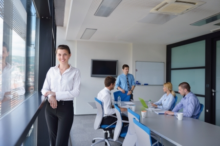 Group of happy young  business people in a meeting at office Stock Photo - 15528200