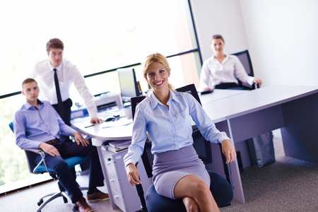business woman  with her staff,  people group in background at modern bright office indoors photo