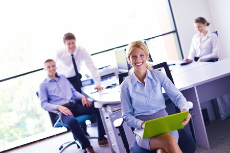 business woman  with her staff,  people group in background at modern bright office indoors Stock Photo - 15527235