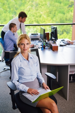 business woman  with her staff,  people group in background at modern bright office indoors Stock Photo - 15528196