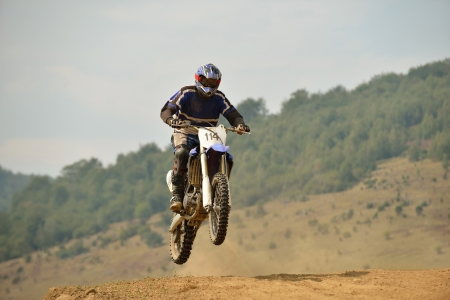 sports race: motocross bike in a race representing concept of speed and power in extreme man sport