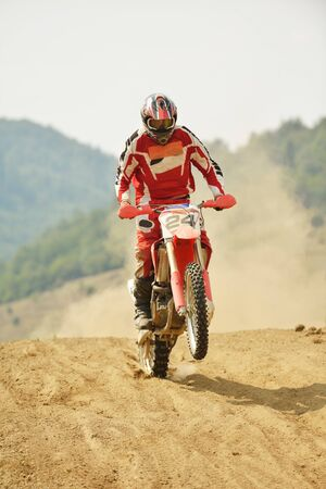 motor cycle: motocross bike in a race representing concept of speed and power in extreme man sport