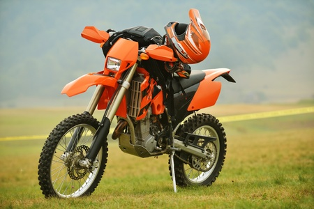 bike trail: motocross bike in a race representing concept of speed and power in extreme man sport