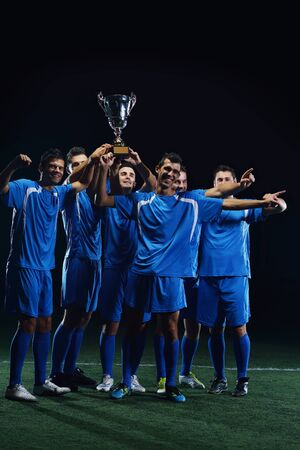 soccer players team group celebrating the victory and become champion of game while holding win coup Stock Photo - 16292987