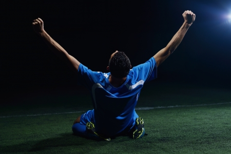 soccer player doing kick with ball on football stadium  field  isolated on black background Stock Photo - 15905824