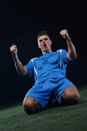 world player: soccer player doing kick with ball on football stadium  field  isolated on black background