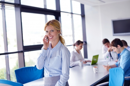 business woman  with her staff,  people group in background at modern bright office indoors Stock Photo - 16112633