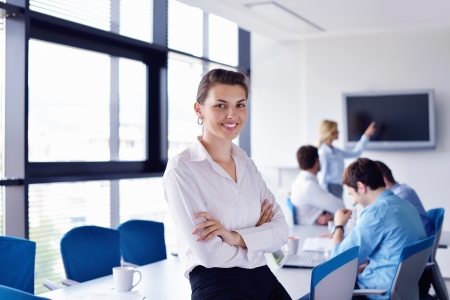 business woman  with her staff,  people group in background at modern bright office indoors Stock Photo - 16112621