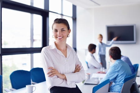 business woman  with her staff,  people group in background at modern bright office indoors Stock Photo - 16112624