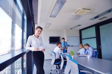 business woman  with her staff,  people group in background at modern bright office indoors Stock Photo - 17628386