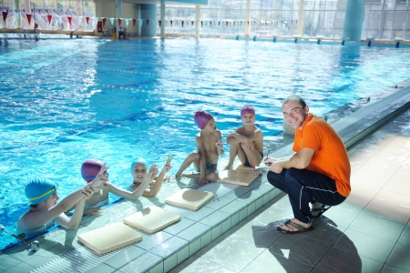 happy childrens group  at swimming pool class  learning to swim photo