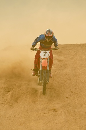 motocross: motocross bike in a race representing concept of speed and power in extreme man sport