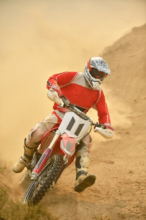 motor bike: motocross bike in a race representing concept of speed and power in extreme man sport