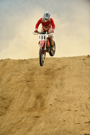motocross bike in a race representing concept of speed and power in extreme man sport photo