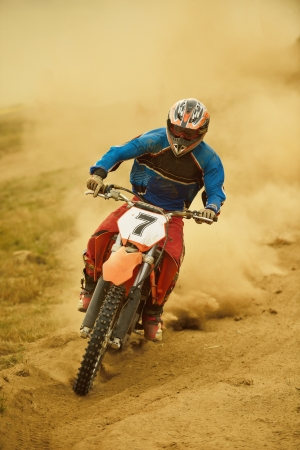 moto: motocross bike in a race representing concept of speed and power in extreme man sport
