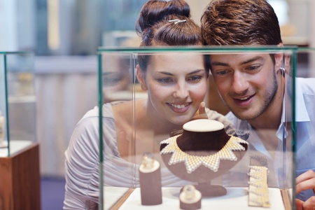 happy young romantic couple in love buy jewelry ring in luxury store Stock Photo - 16504038