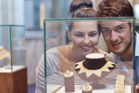 silver jewellery: happy young romantic couple in love buy jewelry ring in luxury store