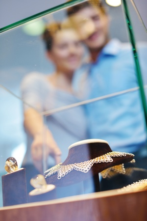 happy young romantic couple in love buy jewelry ring in luxury store Stock Photo - 16209075