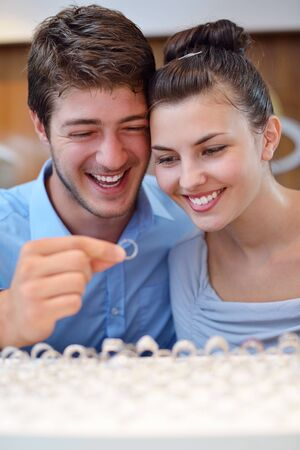 happy young romantic couple in love buy jewelry ring in luxury store Stock Photo - 16503700