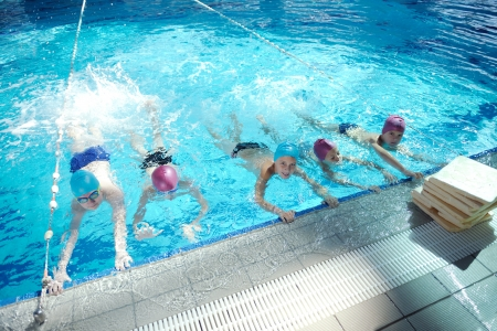swim goggles: happy chid have fun on swimming pool