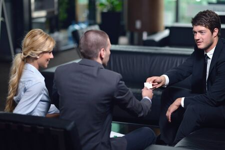 business people shaking hands make deal and sign contract photo
