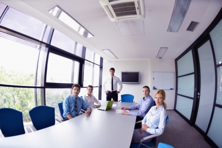 Group of happy young  business people in a meeting at office Stock Photo - 16522972