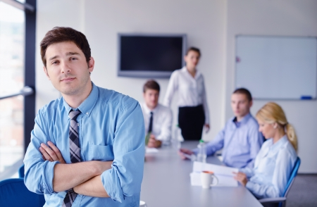 Portrait of a handsome young  business man  on a meeting in offce with colleagues in background Stock Photo - 16523017