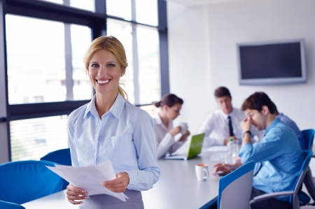 Group of happy young  business people in a meeting at office Stock Photo - 16523060