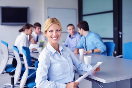 Group of happy young  business people in a meeting at office Stock Photo - 16522889