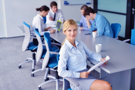 Group of happy young  business people in a meeting at office Stock Photo - 16522945