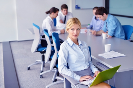 business woman  with her staff,  people group in background at modern bright office indoors Stock Photo - 16522914