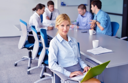 business woman  with her staff,  people group in background at modern bright office indoors Stock Photo - 16522970