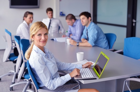 Group of happy young  business people in a meeting at office Stock Photo - 16523028