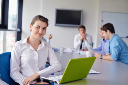 staff training: business woman  with her staff,  people group in background at modern bright office indoors Stock Photo