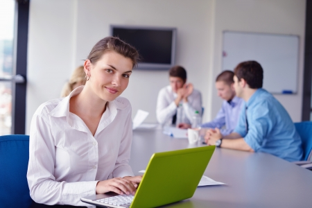 business woman  with her staff,  people group in background at modern bright office indoors Stock Photo - 16522937